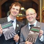 Keighley News: Councillors Alex Ross-Shaw, left, and Adrian Farley with Remembering Srebrenica literature