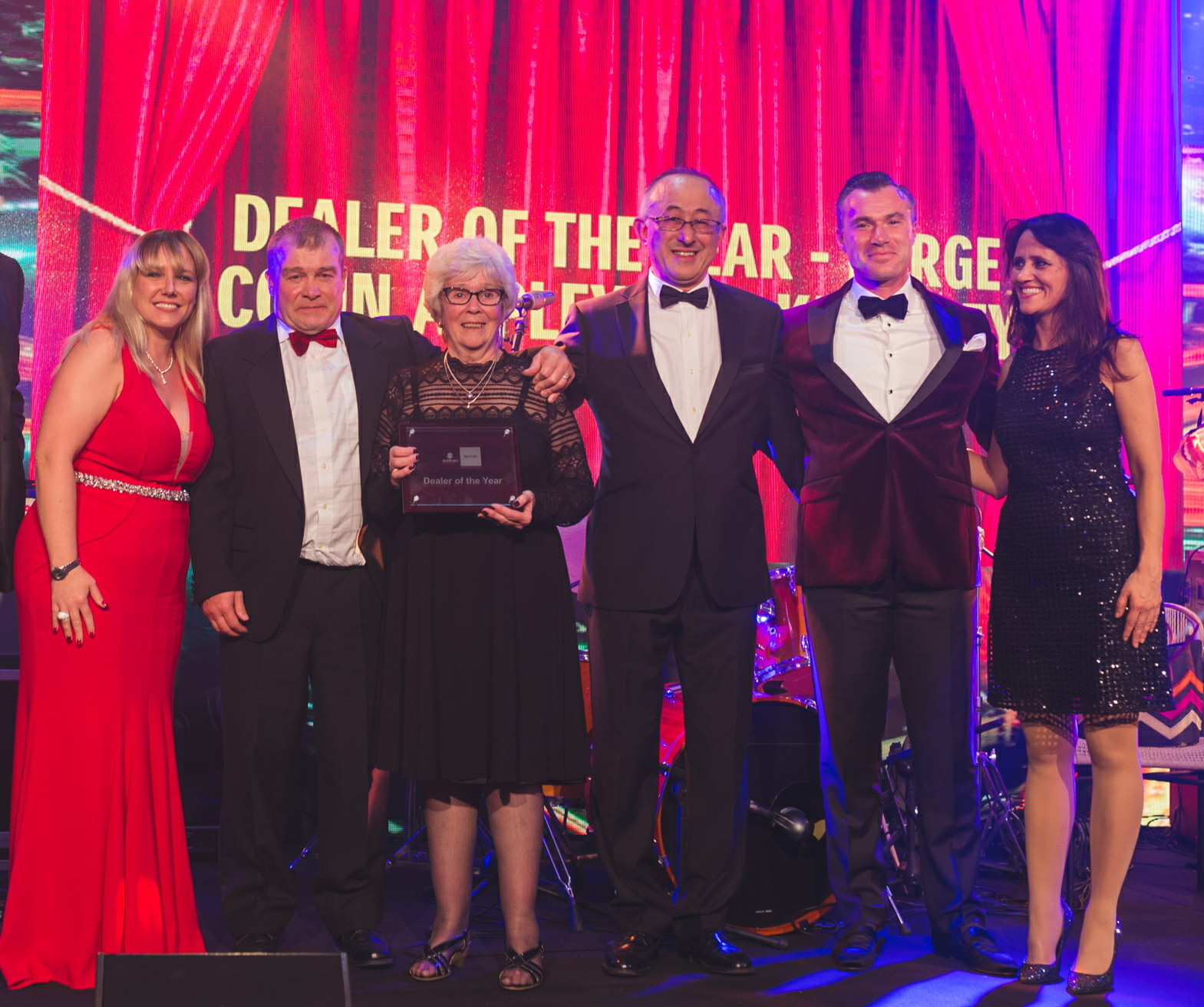 Robin Appleyard, second from left, collects an award at a ceremony last year
