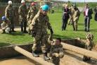 Pupils from University Academy Keighley braving the mud bath at the army camp. Wading through the muck in this picture is student James Robinson.