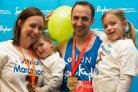 London Marathon runner Jonathan Gallucci celebrates completing the race with, from left, his wife Ceri, son Jacob and daughter Lucy. Photo by Max Turner.