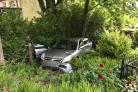 The damaged car pictured amidst undergrowth off Scott Lane