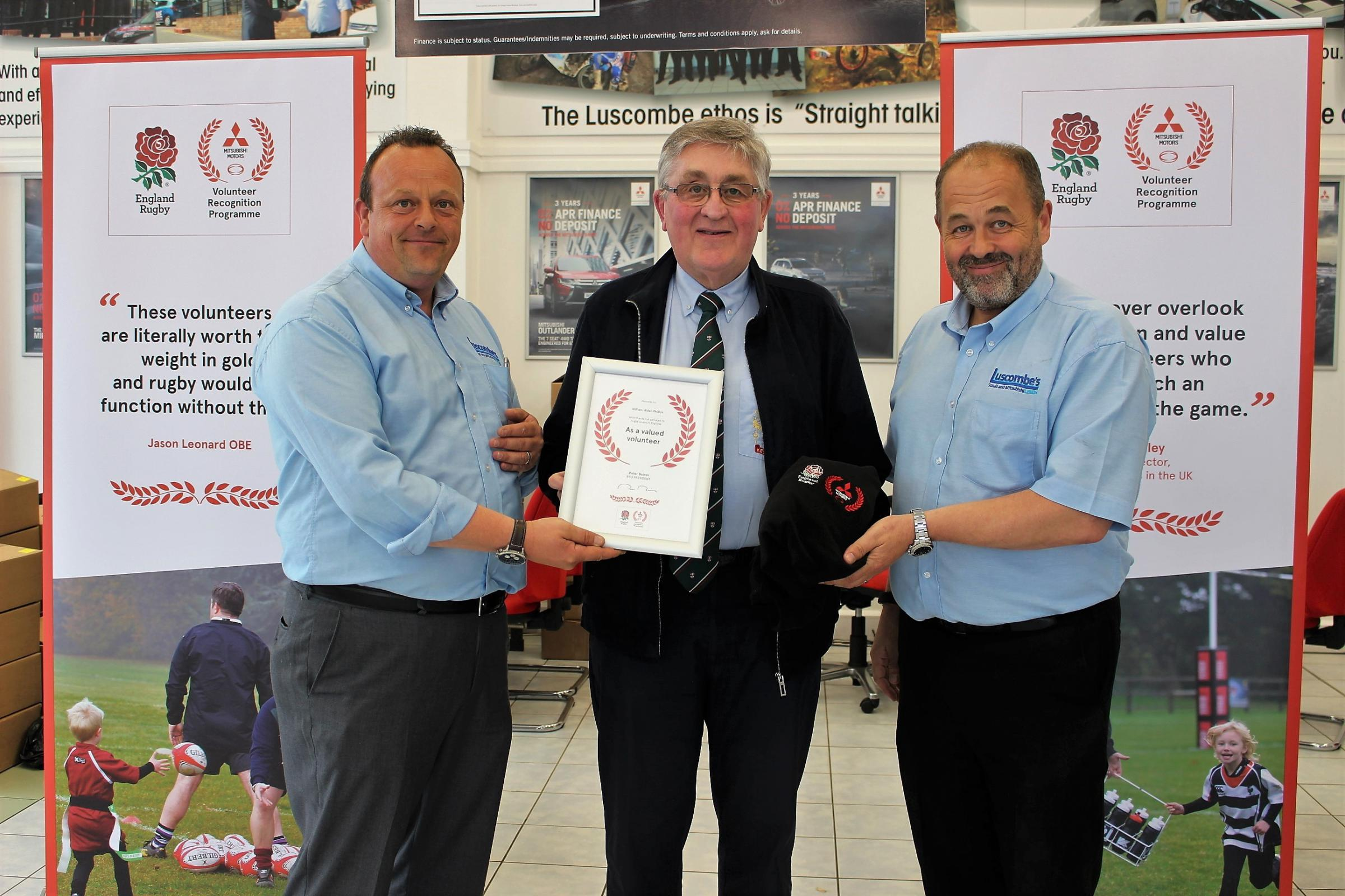 William Alden Phillips, centre, with Graham Smithson, left, and Robin Luscombe of Luscombe Mitsubishi Leeds