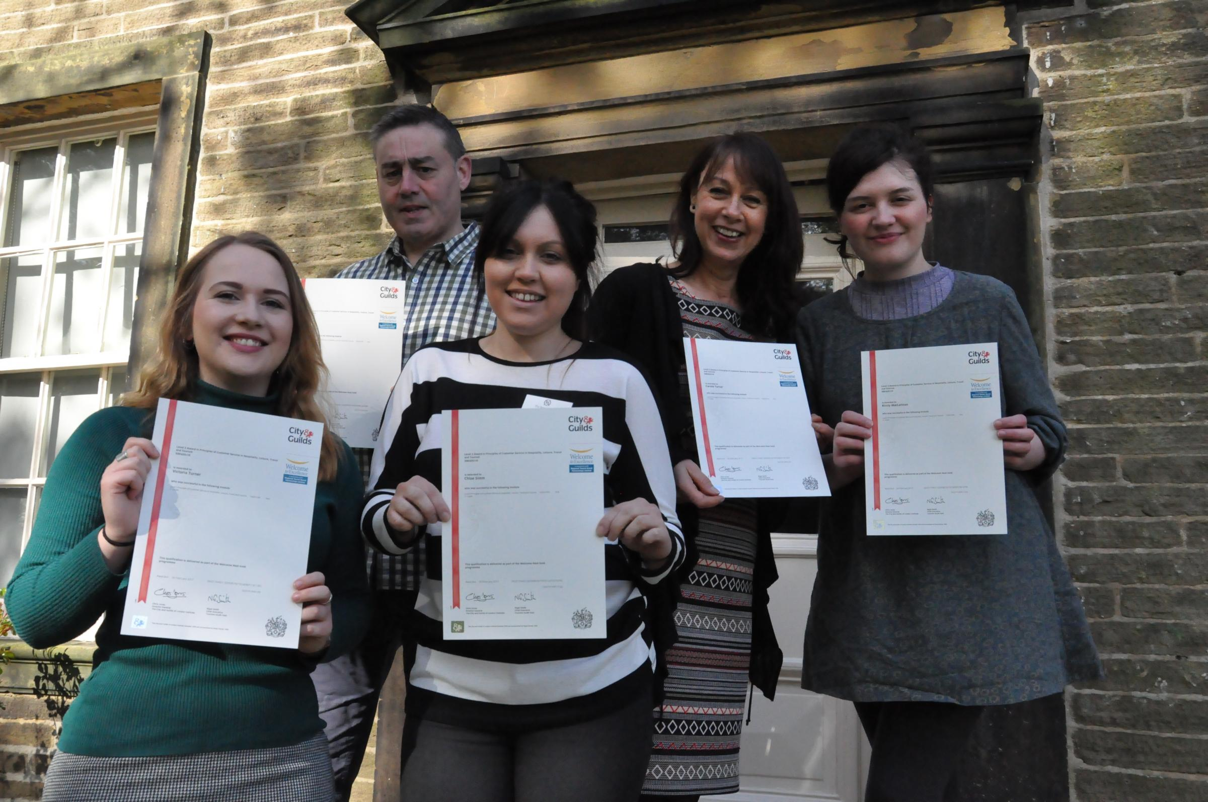 Brontë Parsonage Museum staff have been awarded litigations for improving customer service skills, from left, Victoria Turner, Mark Davies, Chloe Simm, Carole Turner, Kirsty Maclennan