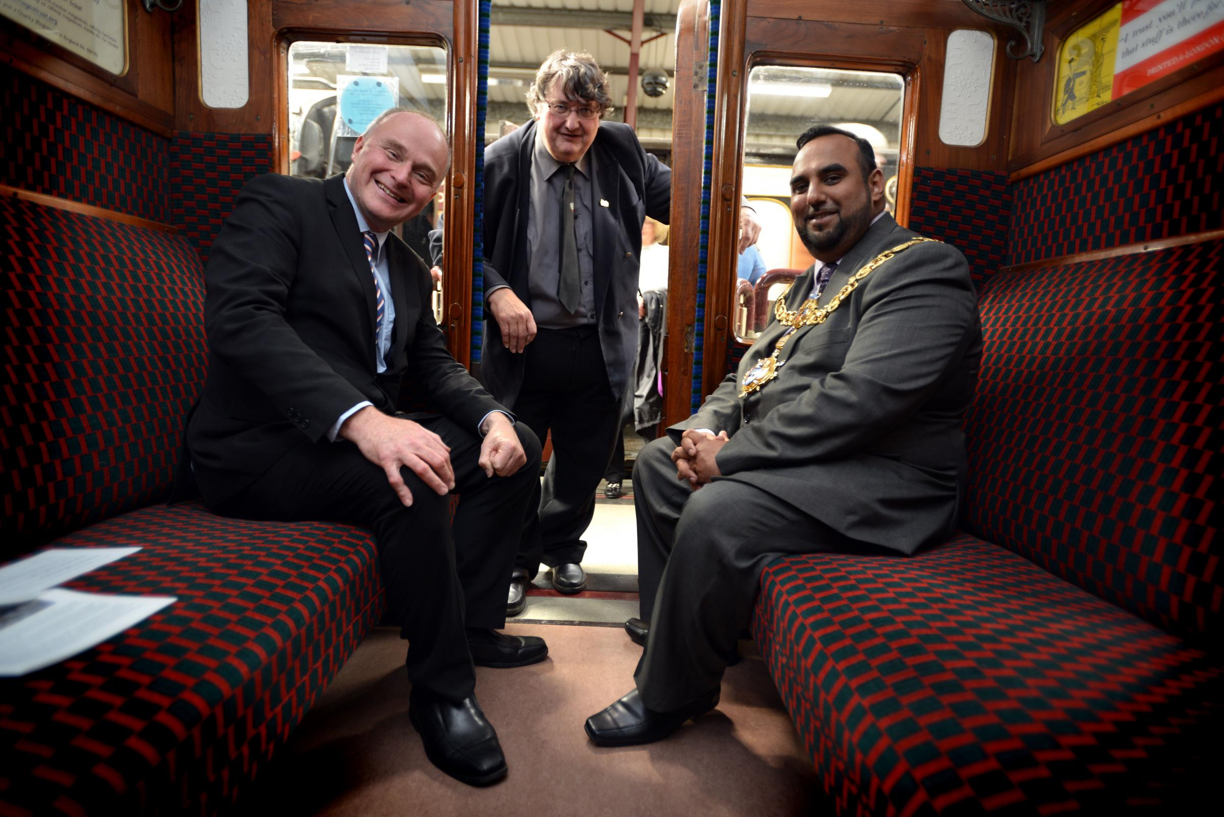 John Grogan MP and the Mayor of Keighley Councillor Mohammed Nazam seated with Keith Whitmore between themas they visit the Ingrow station exhibitions for the opening of National Heritage Days at the Keighley Worth Valley railway..