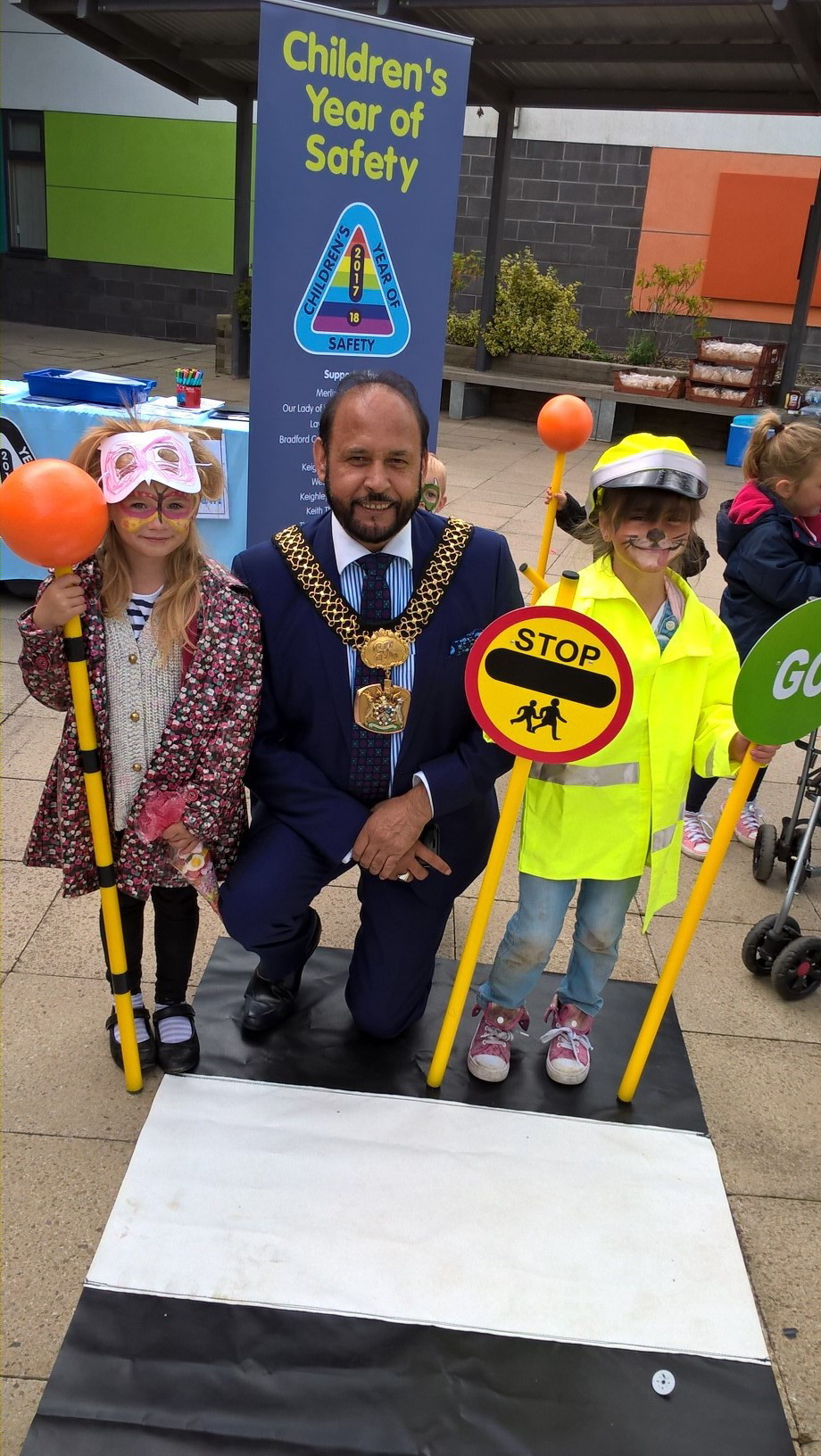 Lillie Mae Wilkinson, five, and Tia-Rose Curry, six, help the Lord Mayor of Bradford, Cllr Abid Hussain, brush-up on road safety at Braithwaite and Guard House Gala