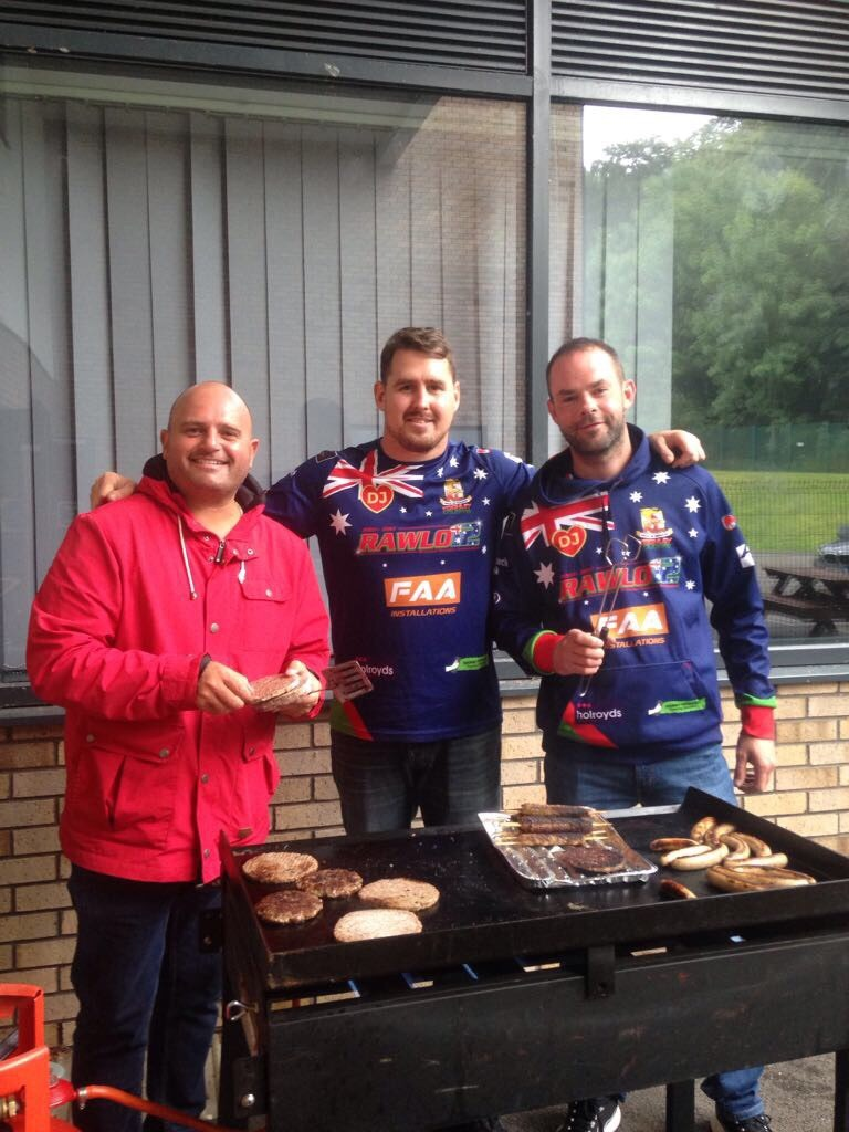 Brendon Rawlins, centre, stands with fellow Brendon Rawlins Testimonial Committee Members to run the barbecue at the Keighley Cougars family fun day in the Airedale Shopping Centre