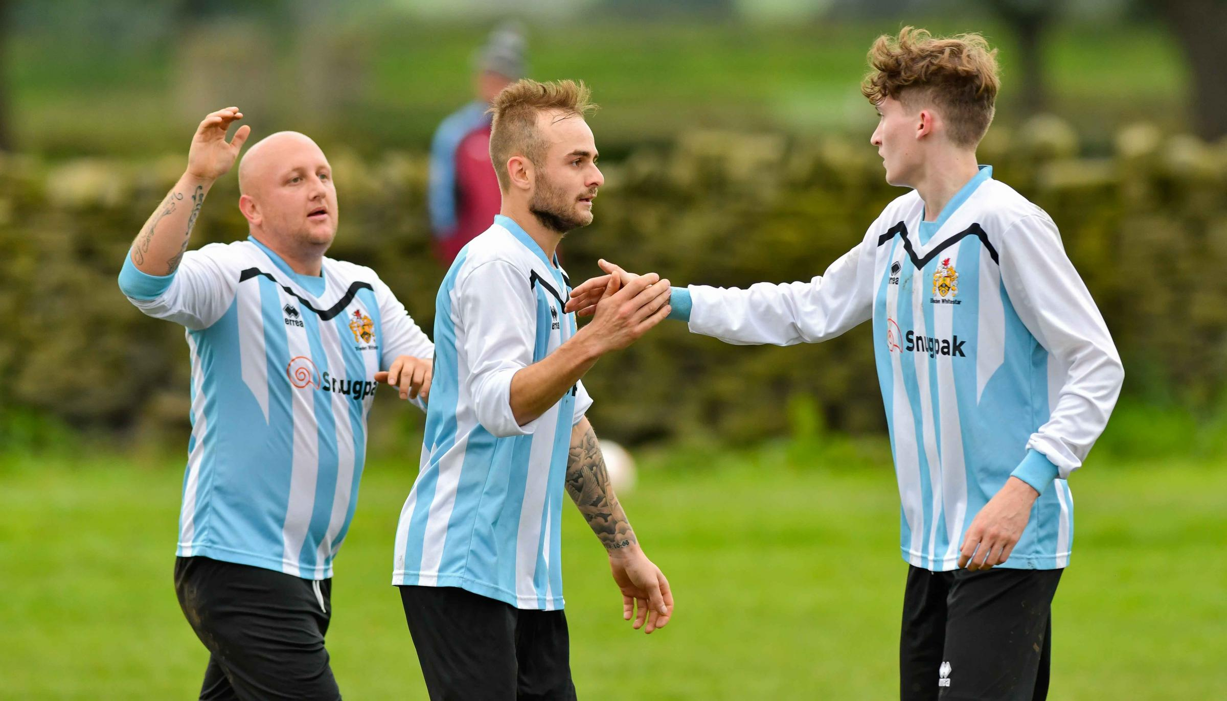 Sam Stanfield, centre, was on target for Silsden Whitestar Reserves