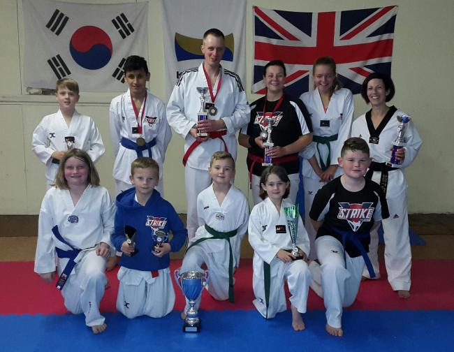 Strike Taekwondo show off their trophies at the England Open Autumn Championships in Manchester