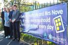 Pictured with one of the banners are, from left, Councillor Adrian Farley, Merlin Top Academy head Lesley Heathcote, Our Lady of Victories head John Devlin and Laycock Primary headteacher Juliet Nove