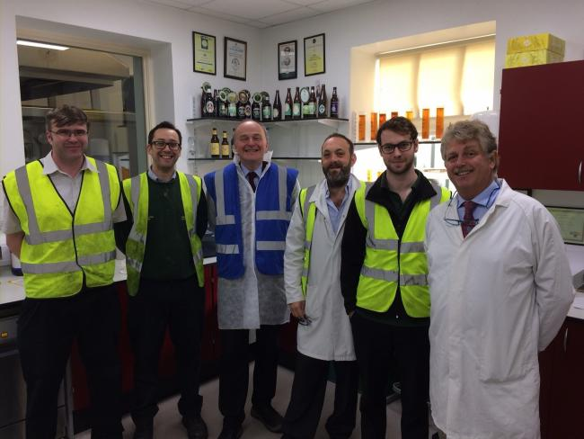 MP John Grogan, third from left, with – from left – Taylor's senior brewers Ewan Sneddon and Tom Slack, second brewer Nick Berkovits, junior brewer Gordon McCallum and head brewer Andy Leman