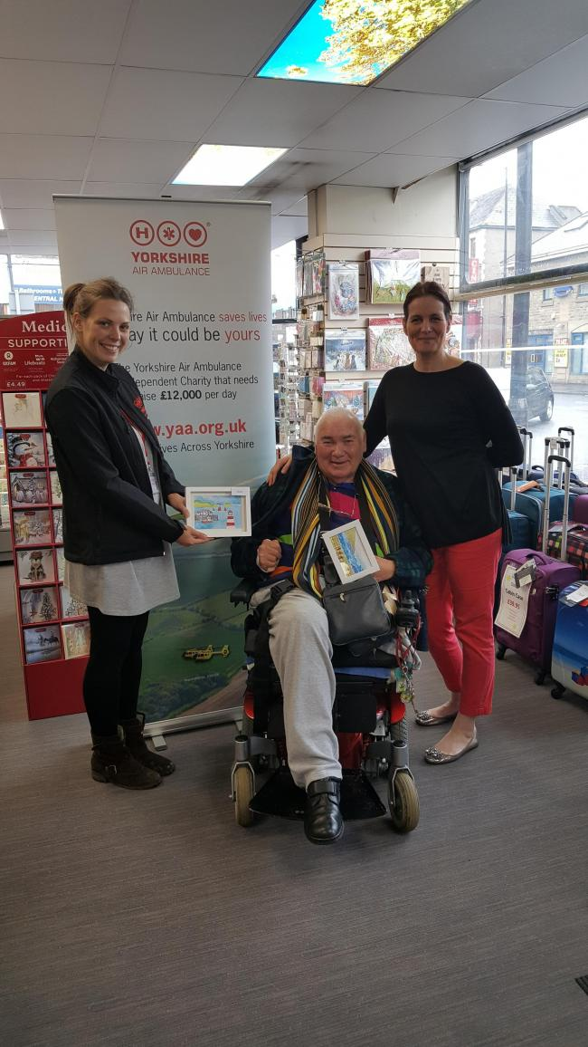 Artist Michael Shearing and Helen Avison from Small Office Supplies, have launched an art display, pictured with Jenny Jones, right, West Yorkshire regional fundraiser for the Yorkshire Air Ambulance.
