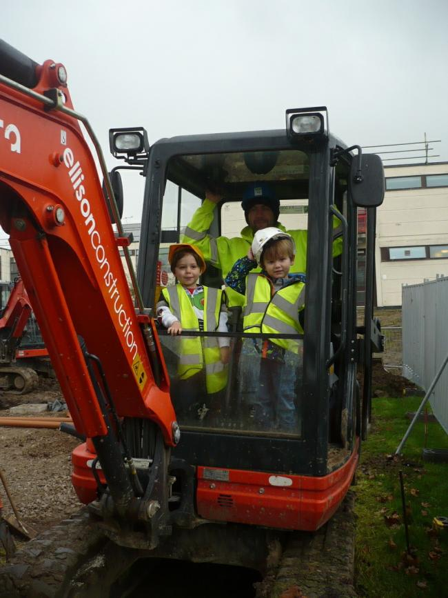 Youngsters Louie Duffy, left, and Charlie Raw get hands-on as work starts on the extension to Nightingales Day Nursery