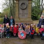 Keighley News: Youngsters and staff from Bridge House Nursery and Pre-school at the war memorial