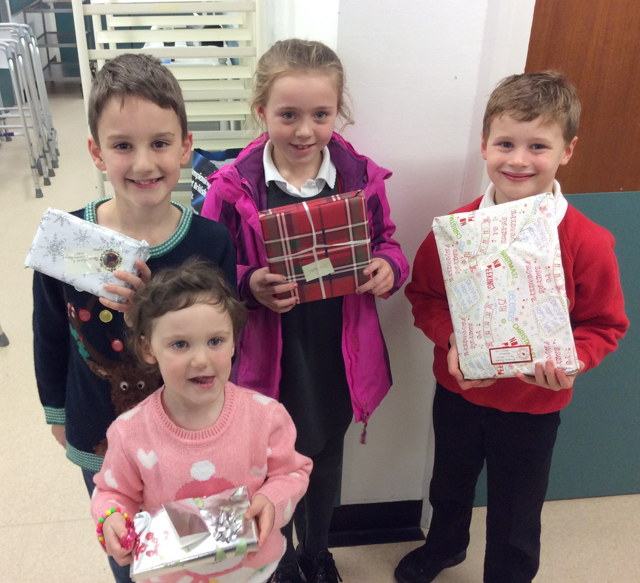 Cononley Primary School pupils Charlie and Georgia Rowe, Jorja-Lou Scarr and Alexander Duffey with some of the gifts