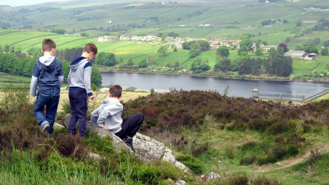 Amanda Taylor took this photo of boys playing overlooking the Lower Laithe Reservoir and Stanbury.