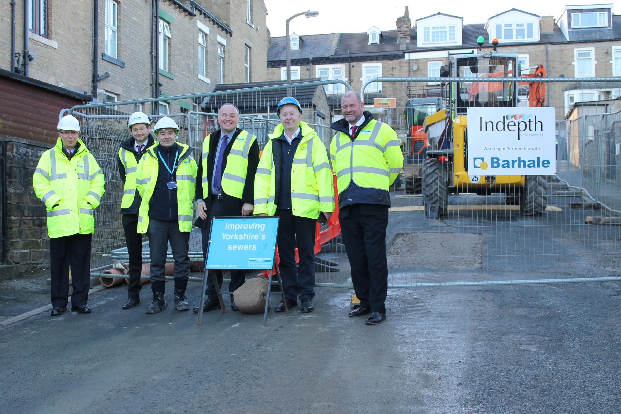 MP John Grogan, third from right, with engineers working on the sewer scheme