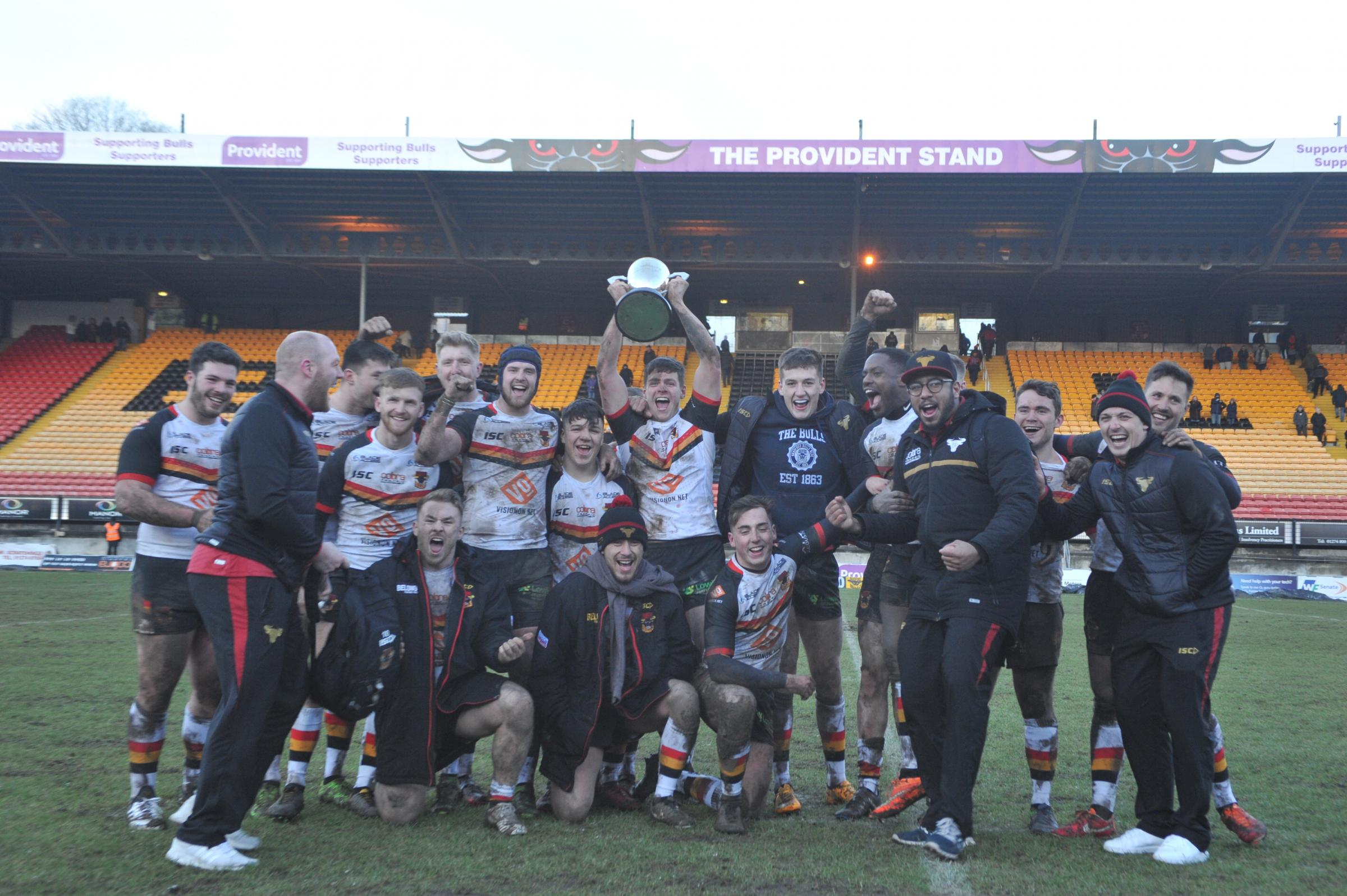 Bulls players celebrate after reclaiming the Joe Phillips Memorial Trophy from Keighley – Picture: Tom Pearson