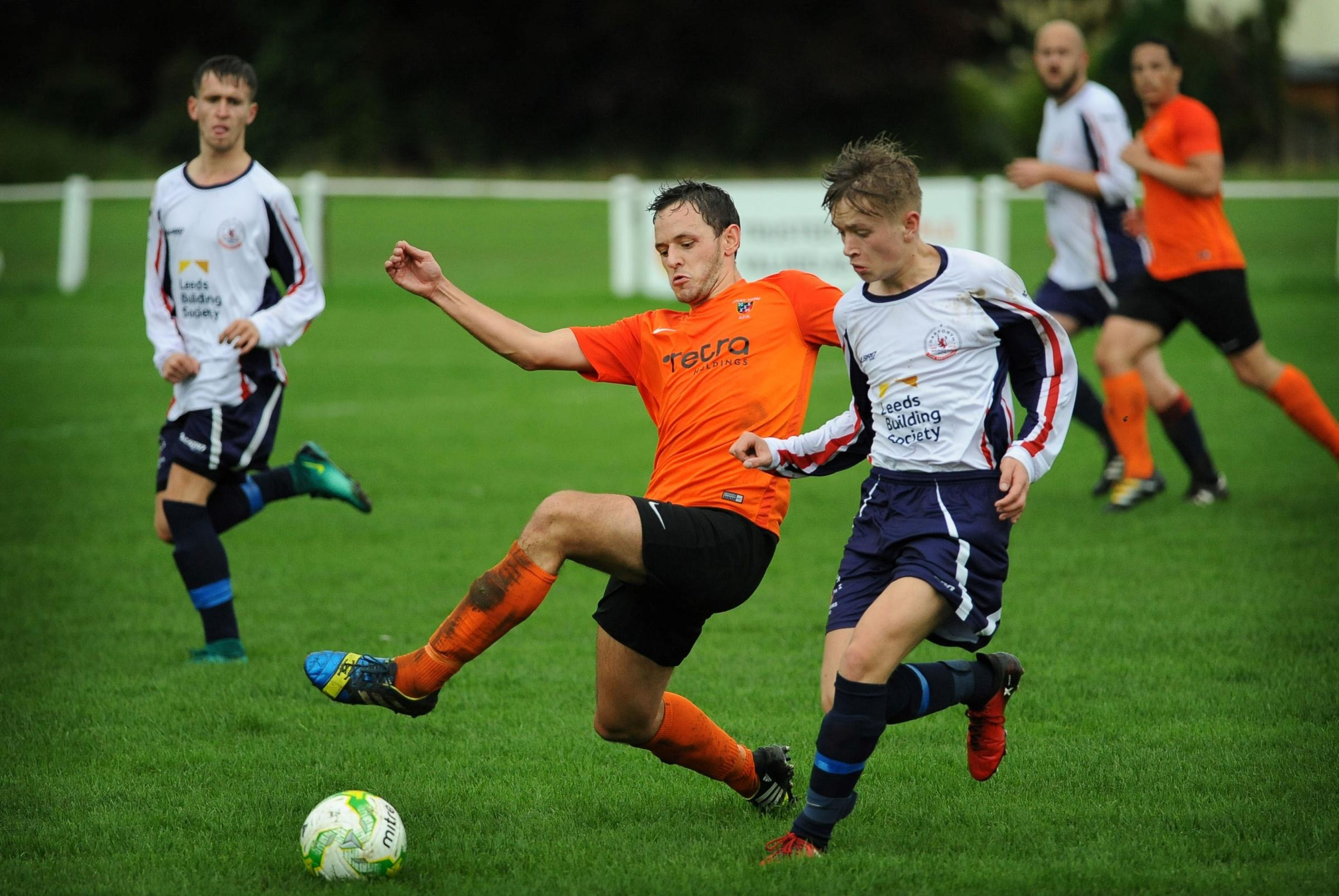 Otley Town's Harry Leigh (orange shirt) worked hard to keep Newsome's pacy attack at bay