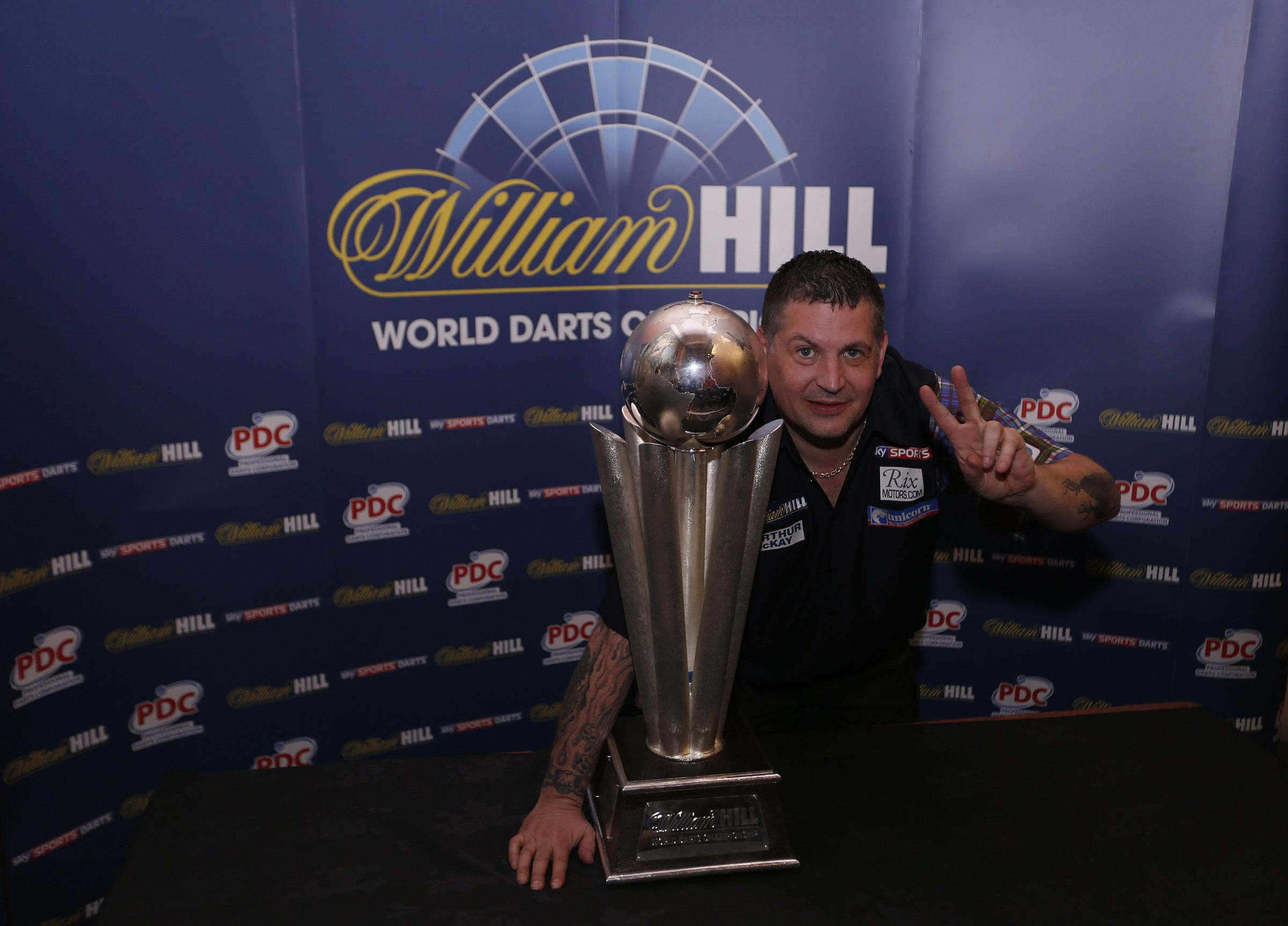 Gary Anderson celebrates Sid Waddell trophy after winning this second world title