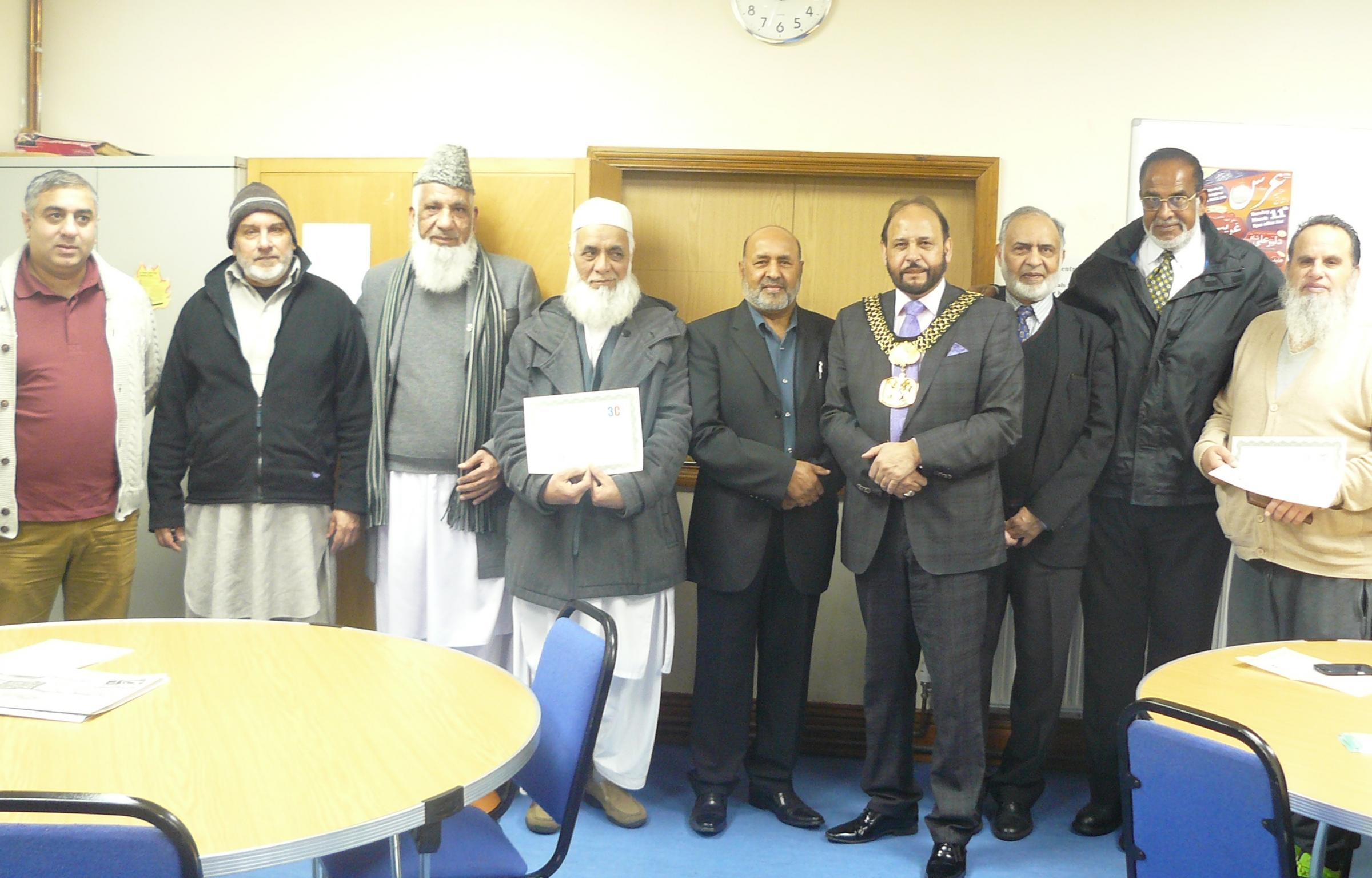Lord Mayor Councillor Abid Hussain, fourth from left, with people who completed the understanding technology course at the Sangat Centre
