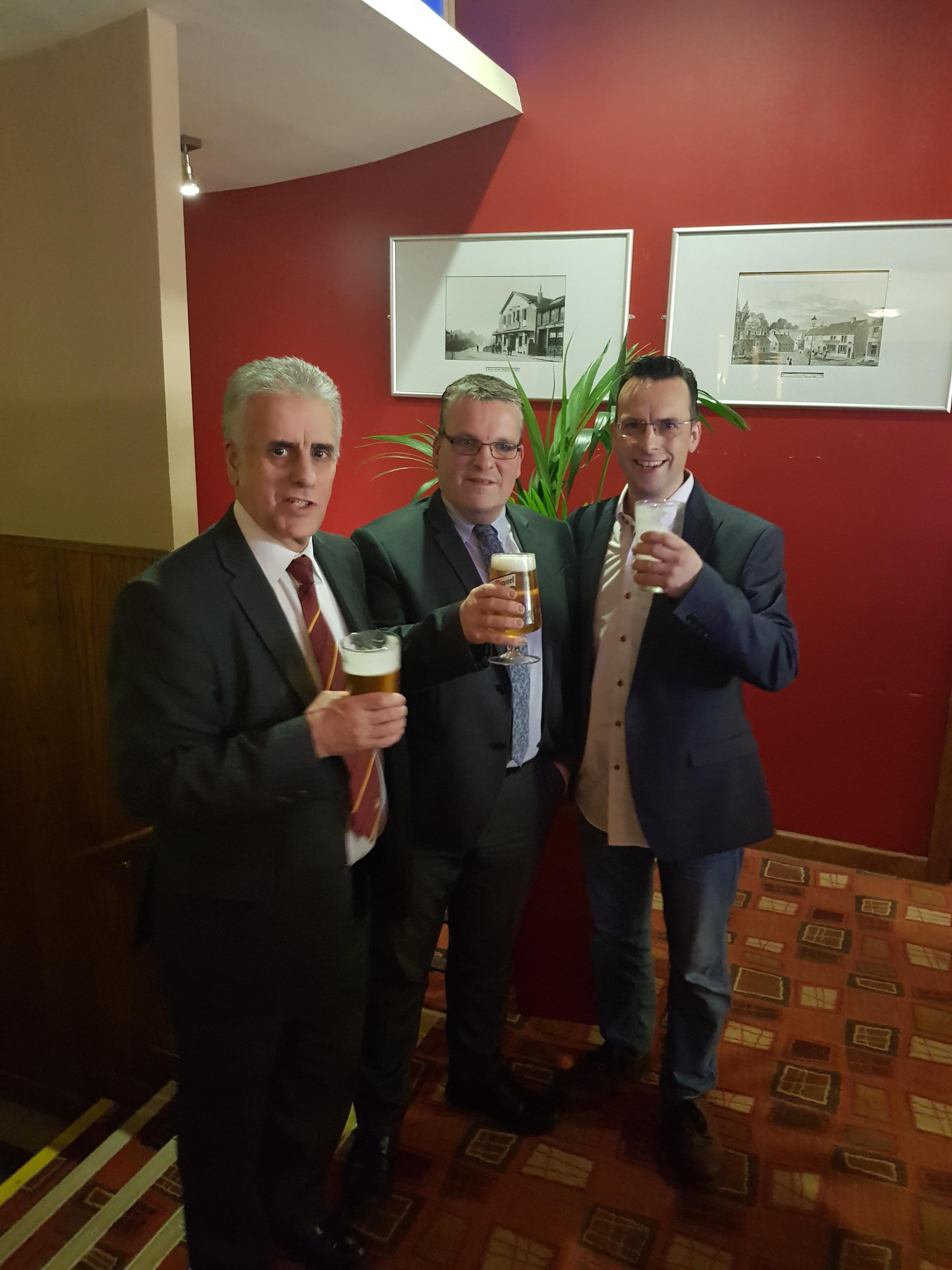 Andrew Vaux, centre, and Ian and John Raper toast the firm's expansion and anniversary