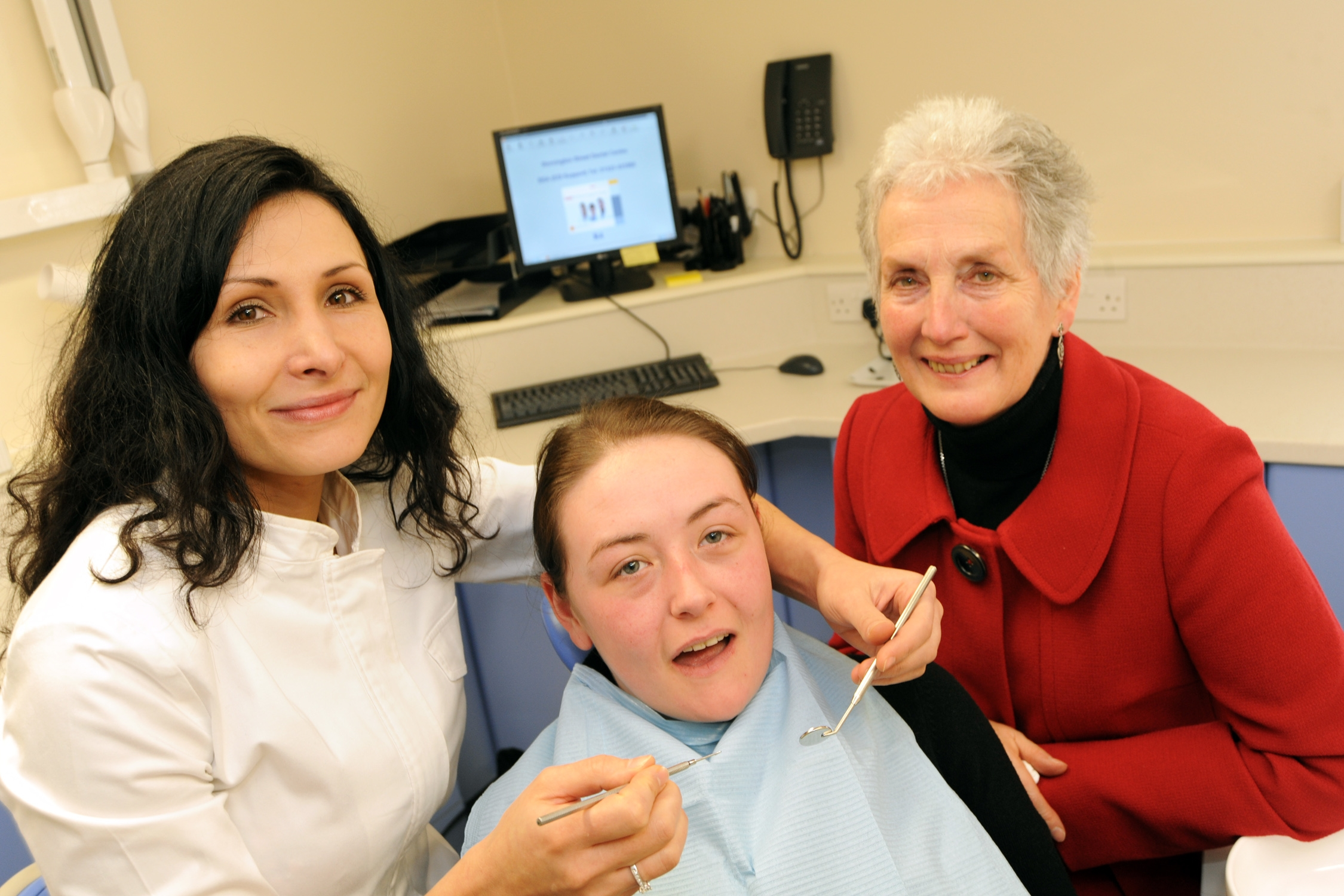 Smile please, it's a  new dental surgery, from left, dentist Dr Tsvetana Lampreva, patient Laine Jackson and MP Ann Cryer