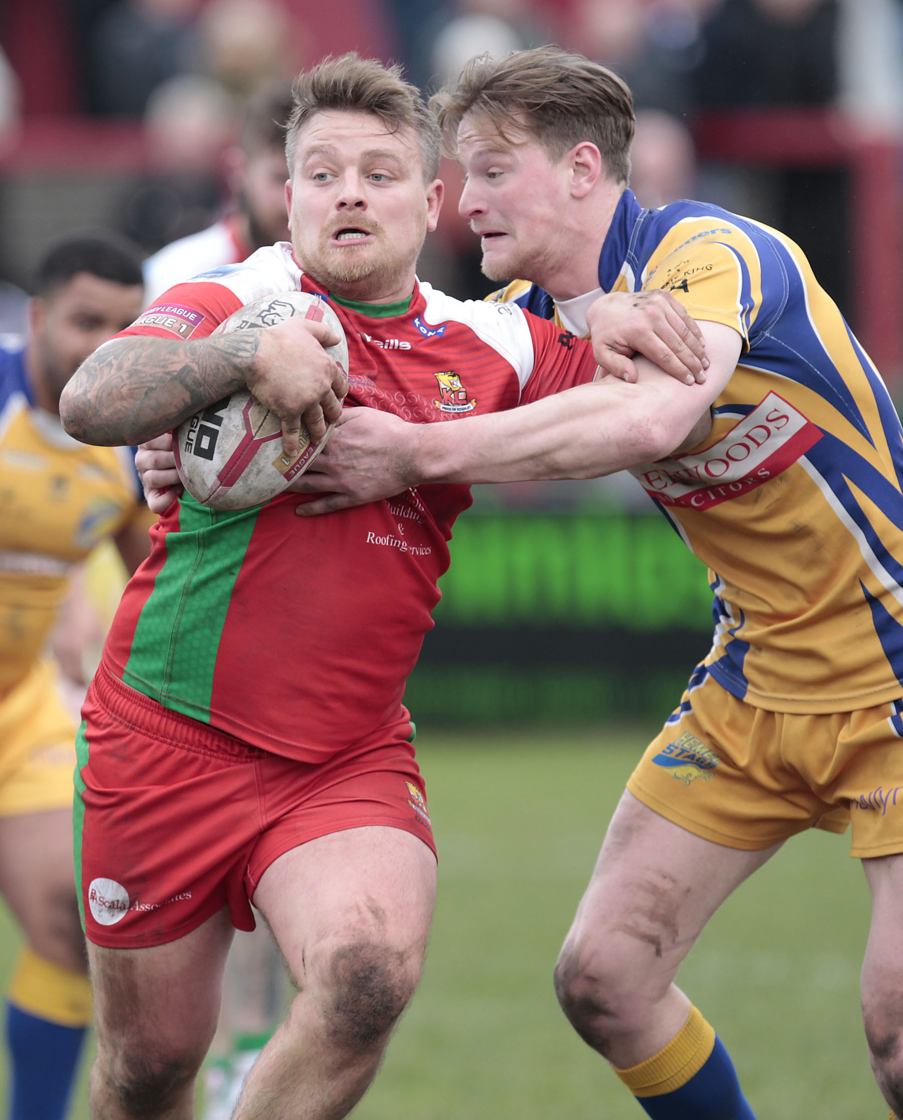 Keighley Cougars' Mike Emmett tries to fend off a Hemel Stags challenge. Picture: Charlie Perry