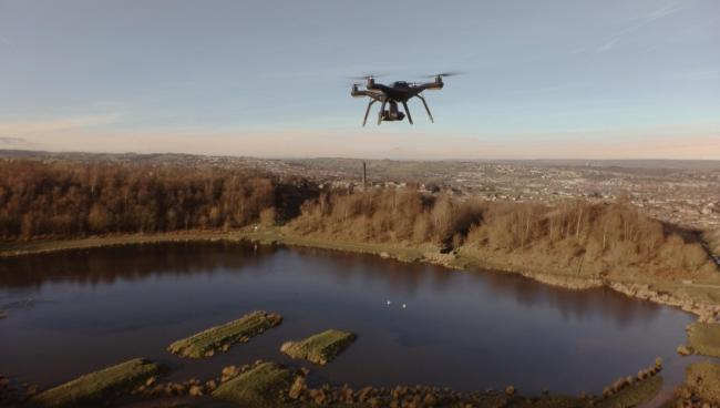 A drone flies over Bradford district
