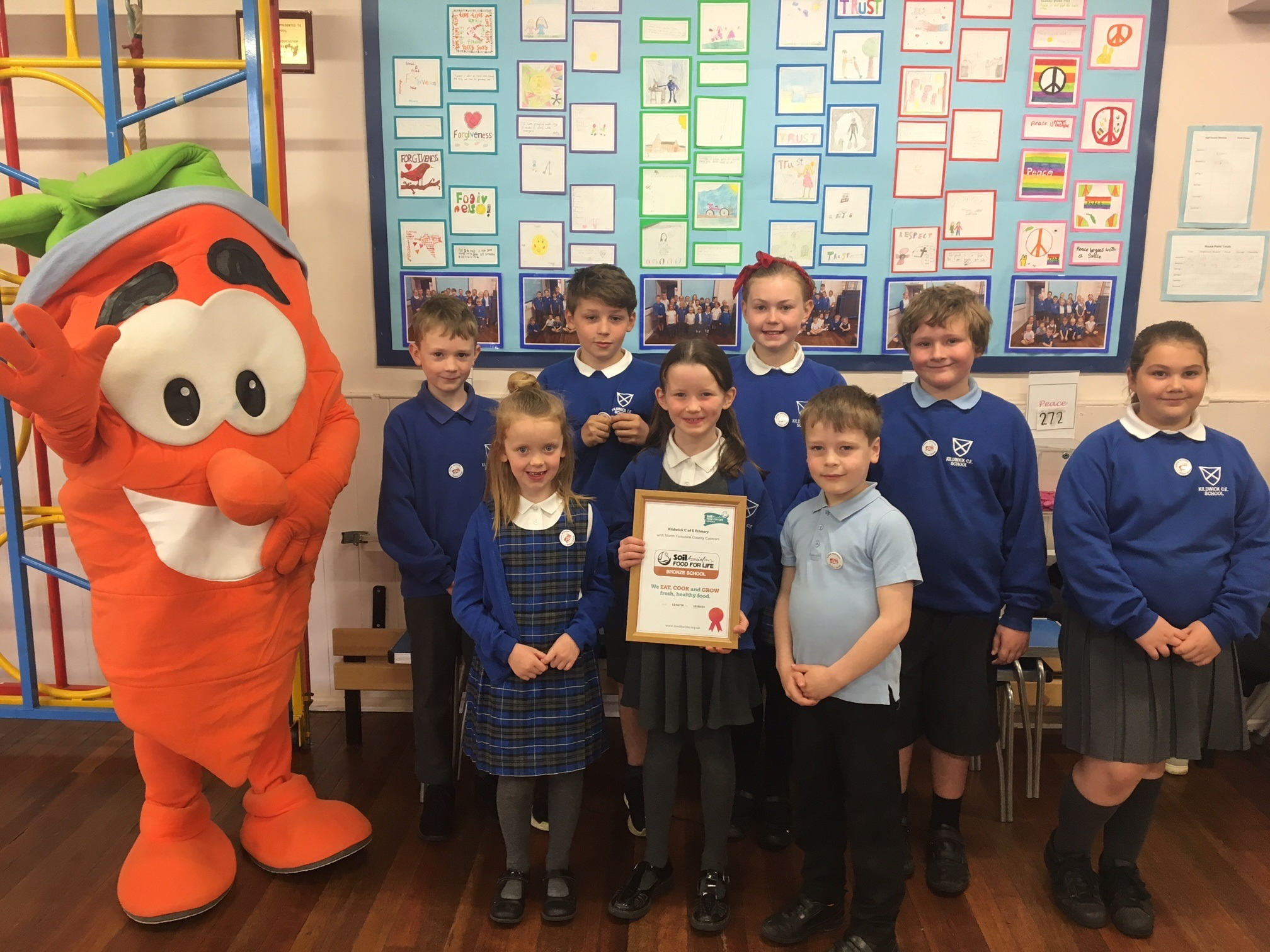 Herbie the Carrot and Food for Life programme manager Ruth Stacey with members of Kildwick School's Nutrition Action Group.