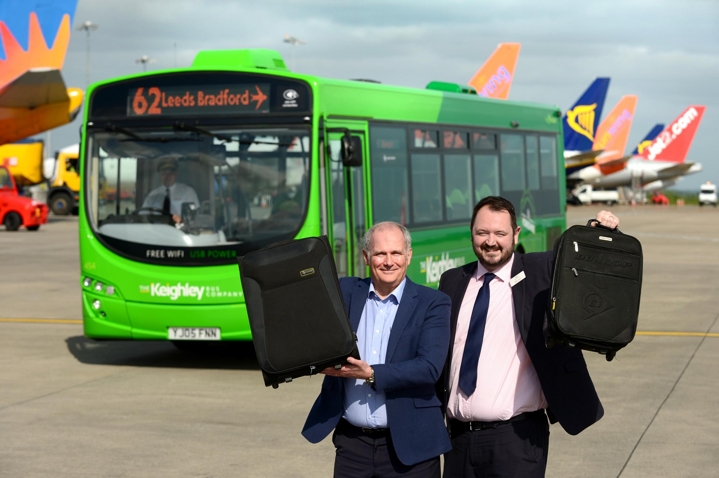 Launching the new 62 bus direct from Keighley to Leeds Bradford Airport is The Keighley Bus Company CEO Alex Hornby and Leeds Bradford Airport Aviation Development Director, Chris Sanders