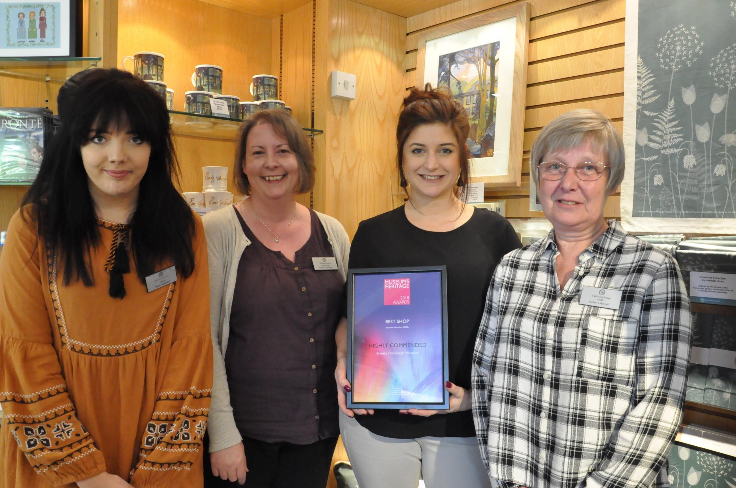 Retail manager Danielle Cadamarteri holds the Brontë Parsonage Museum's Museums + Heritage Award, with, from left, retail assistant Laura Kerry, museum manager Nicola Peel and retail assistant Leigh Perryman.