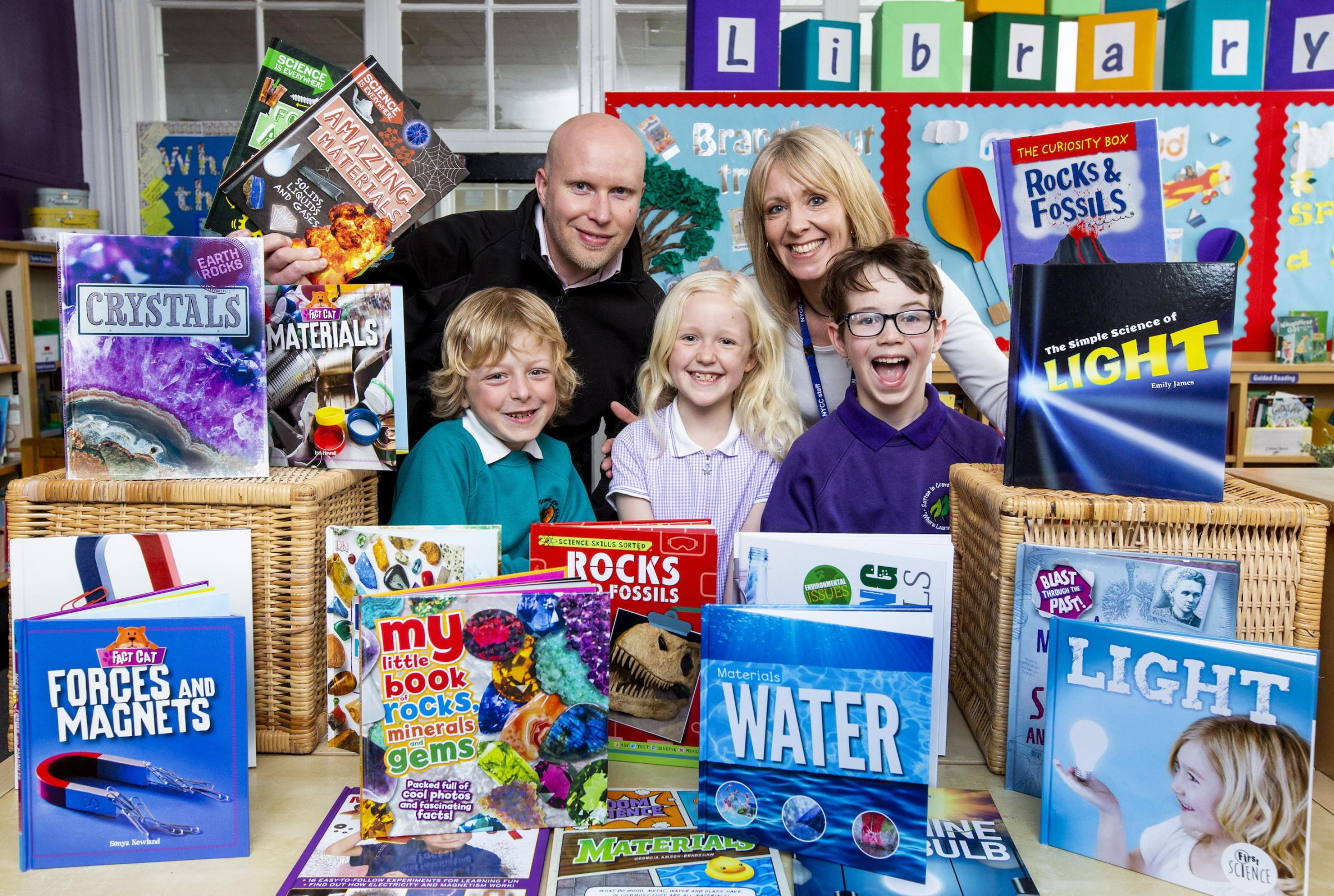 Pictured with the books are Airedale Chemical's Daniel Marr, school librarian Mrs Nicole Broughton and some of the pupils