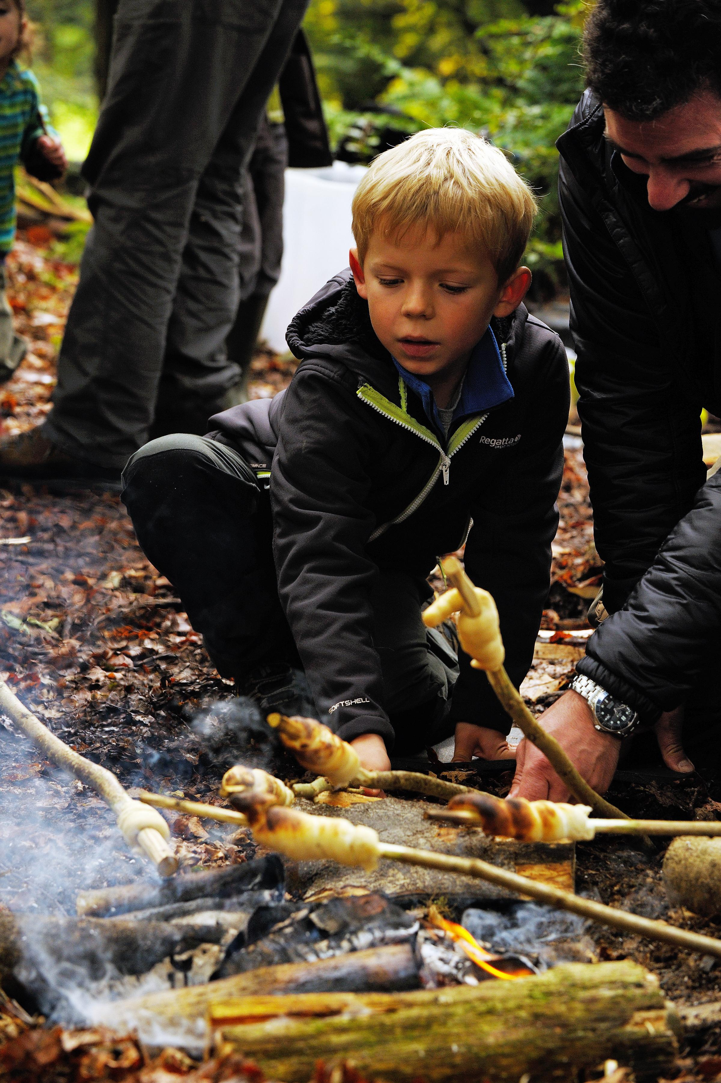 Visitors to the National Trust enjoying woodland activities at
