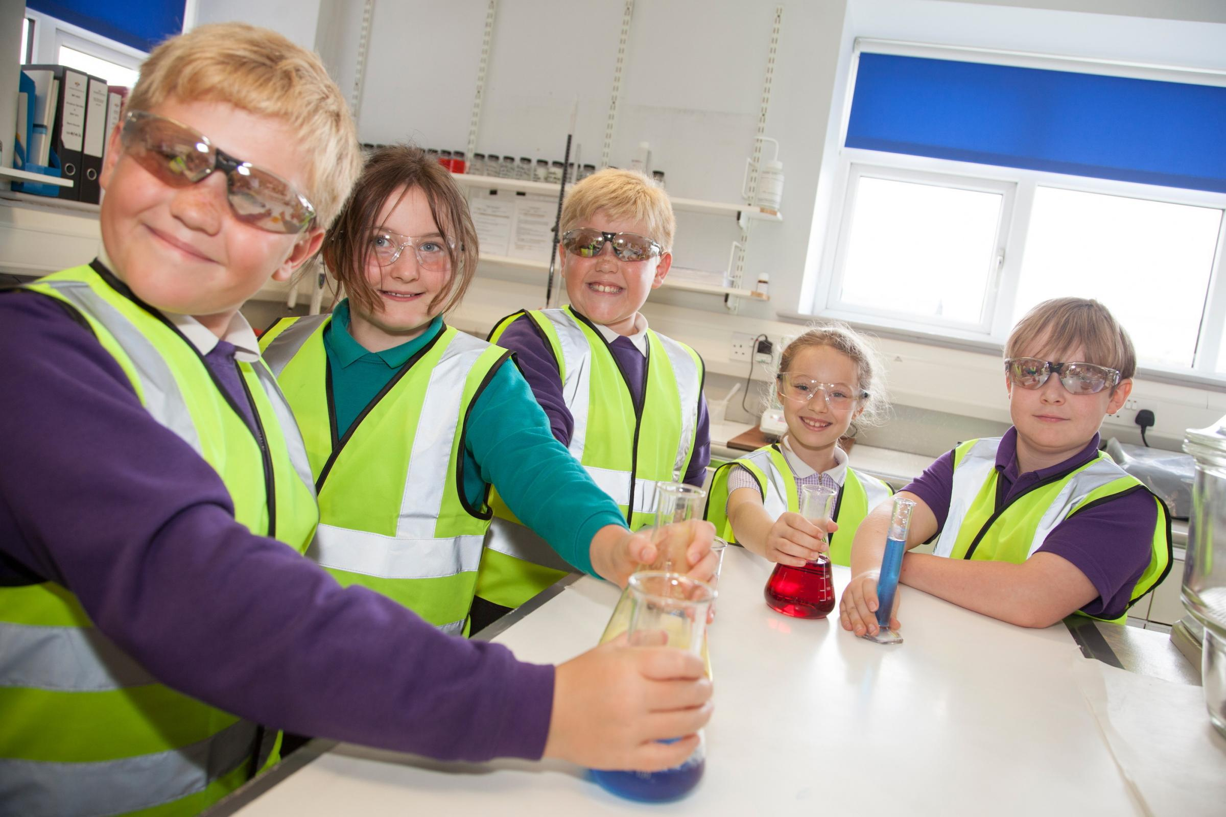 Pupils take part in experiments during the visit to Airedale Chemical