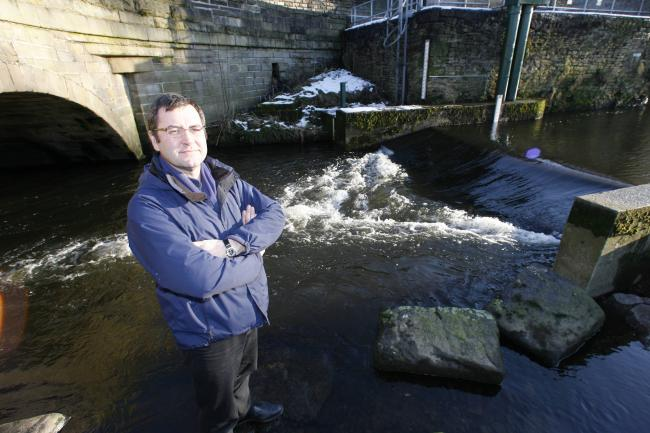 Bob Thorp, one of the people heading the scheme for a hydro-electric plant, at the River Worth, near Low Bridge, Keighley
