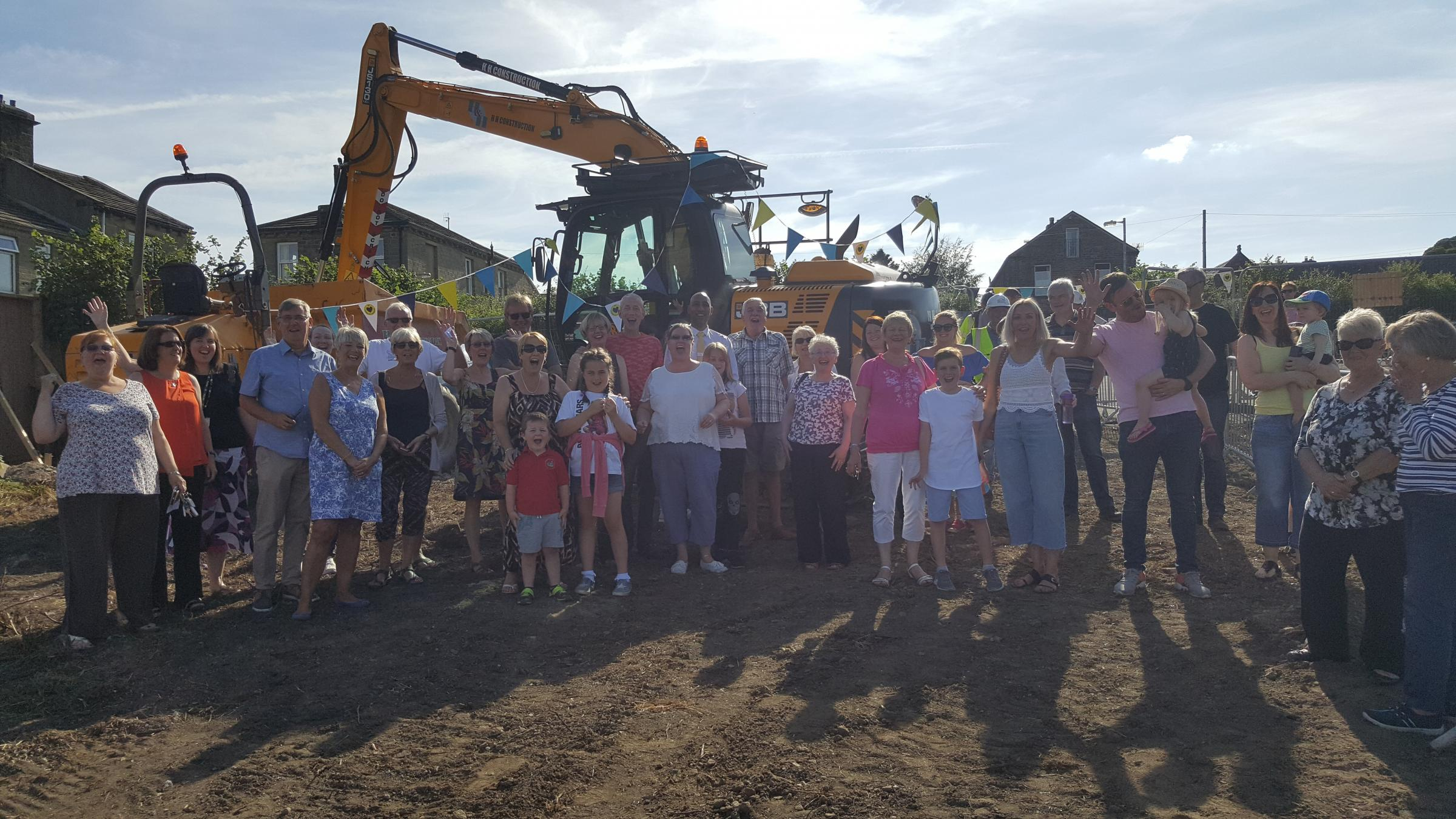 Villagers gather for the ground-breaking ceremony at the site of the new Cullingworth Village Hall