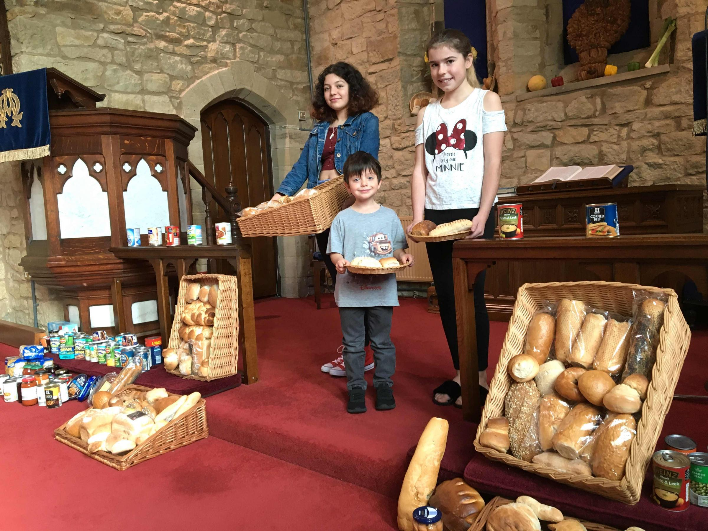 Youngsters with some of the bread at the New Church harvest service