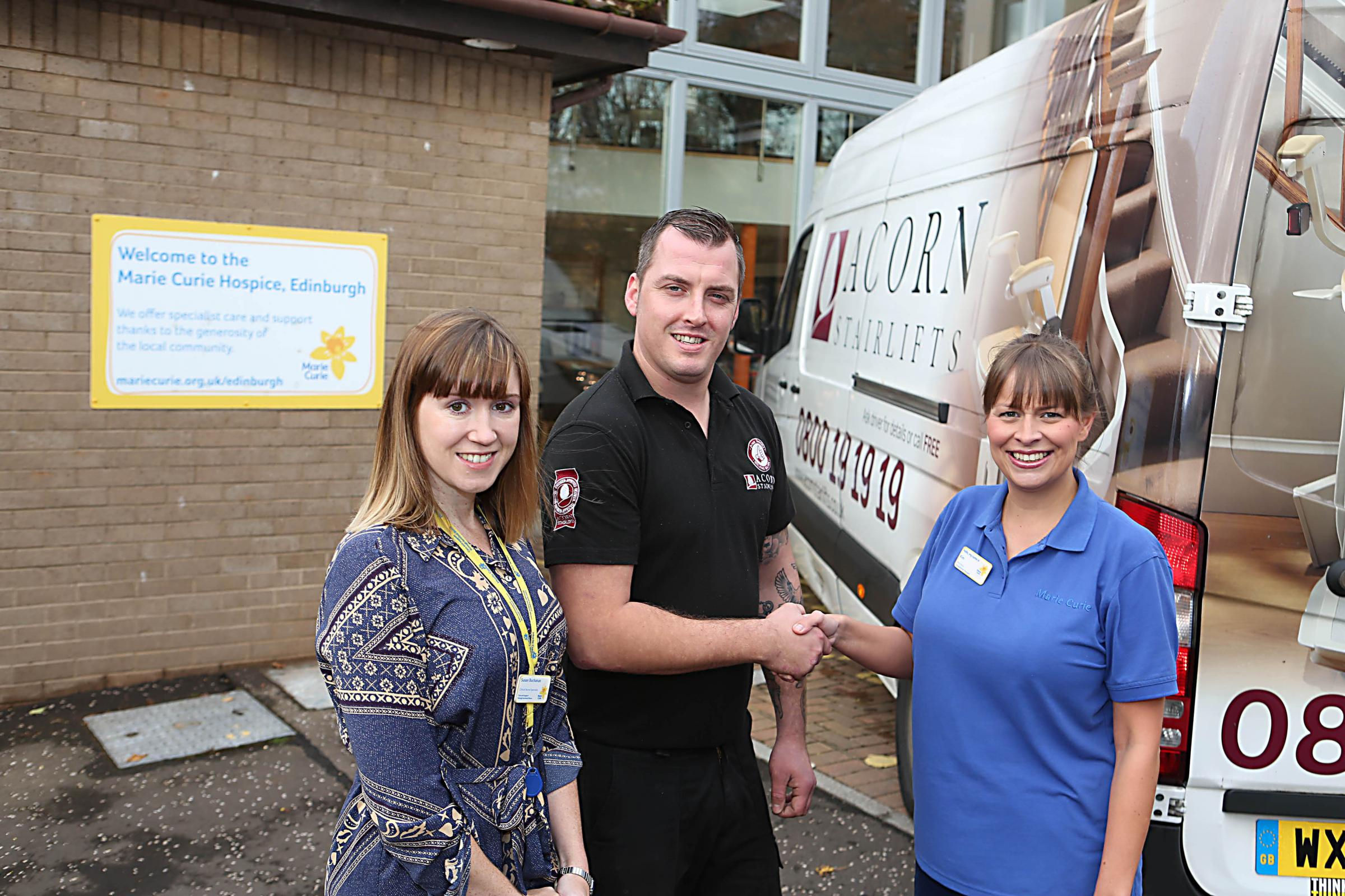 Marie Curie clinical nurse specialist Susan Buchanan, left, with Acorn representative Luke Gorringe and Marie Curie's occupational therapist Kim Pollock