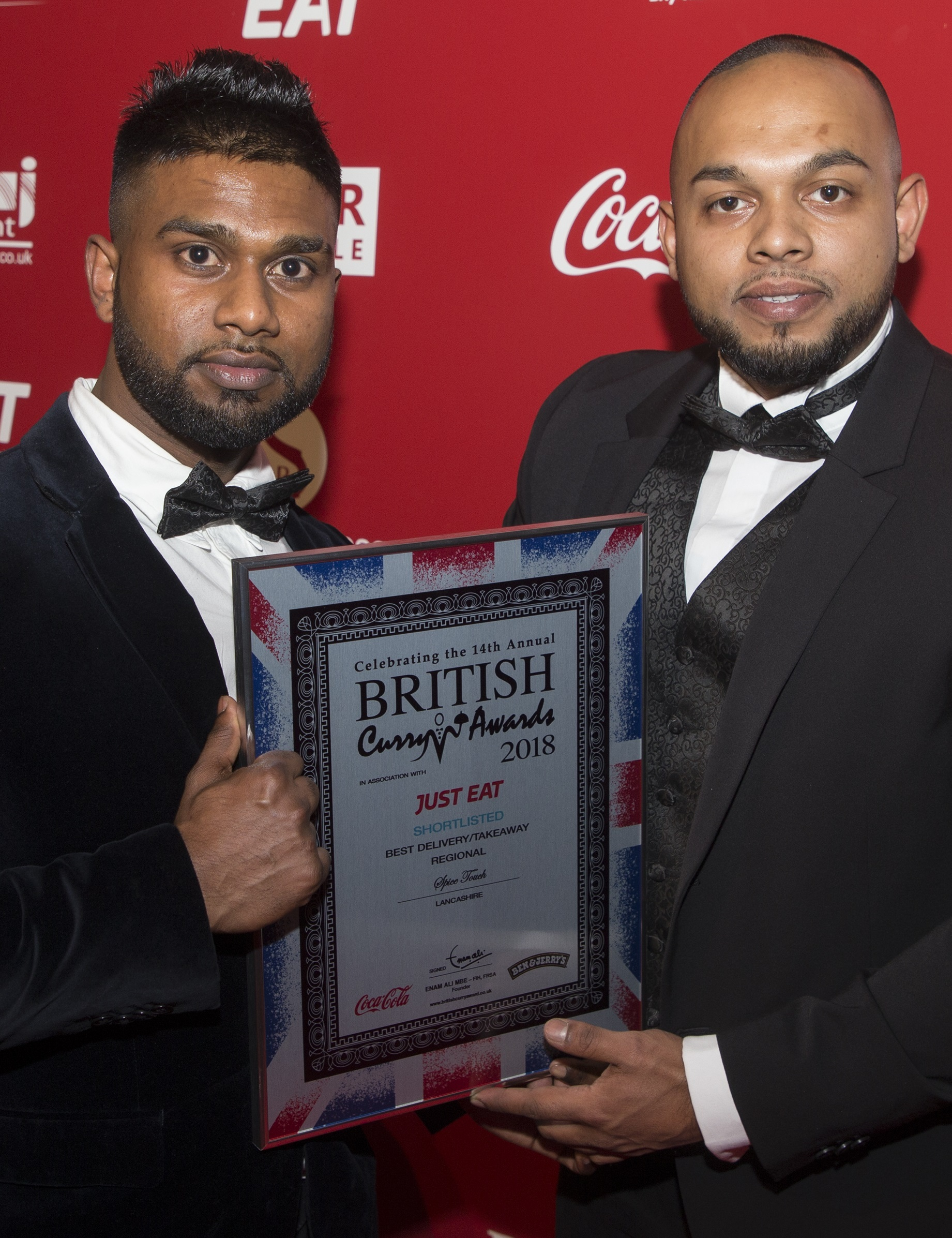 From left, Oly Uddin and Ali Miah with their latest award