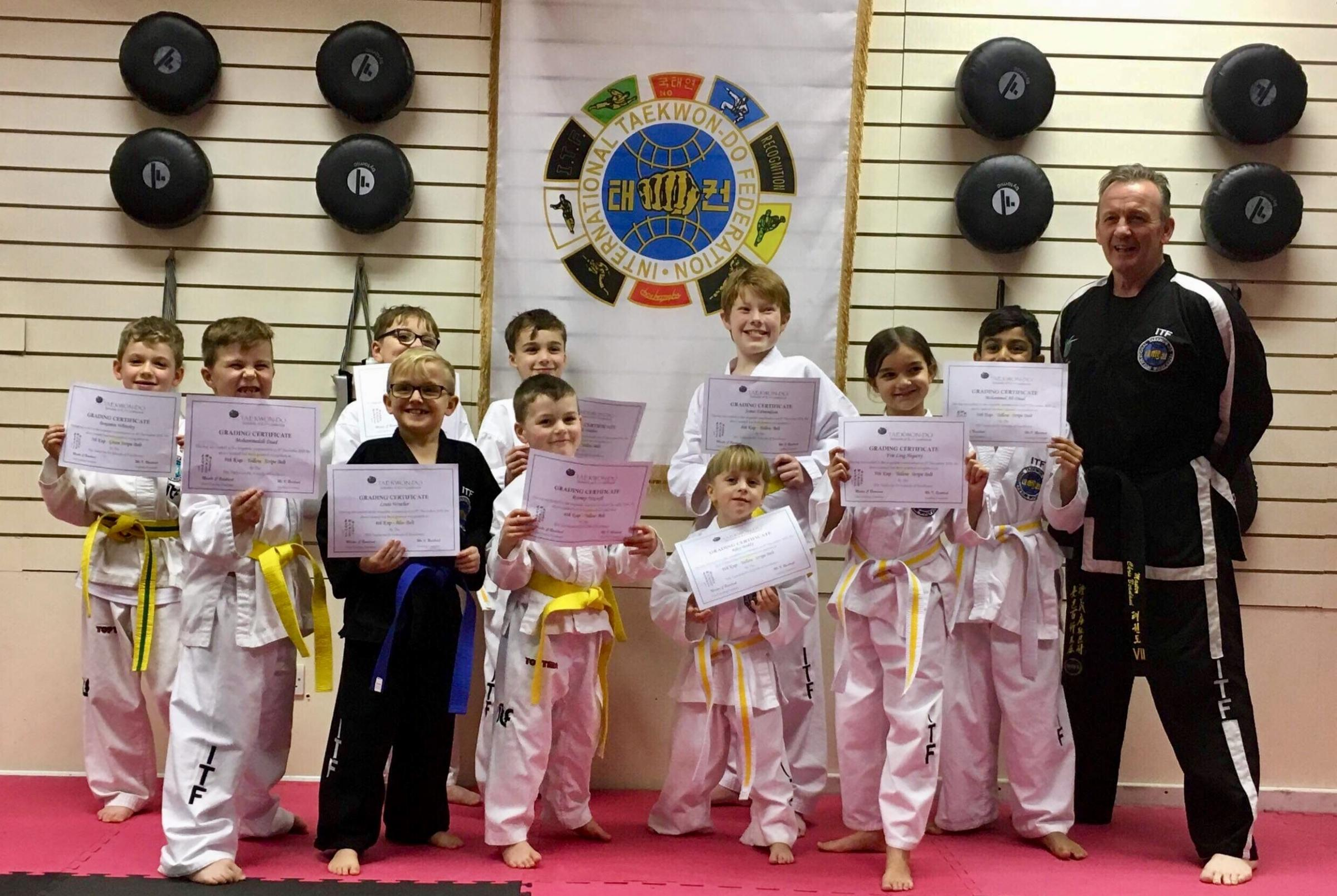 Young members of TSX Keighley Taekwondo celebrate after passing their grading