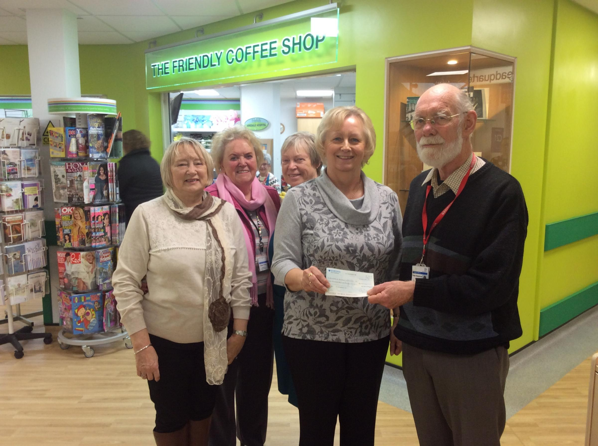 Andrea Moore and Thalia Burton from New2You present a cheque to Friends of Airedale president Eileen Proud and volunteers Peter Beaumont and Brenda Ferridge