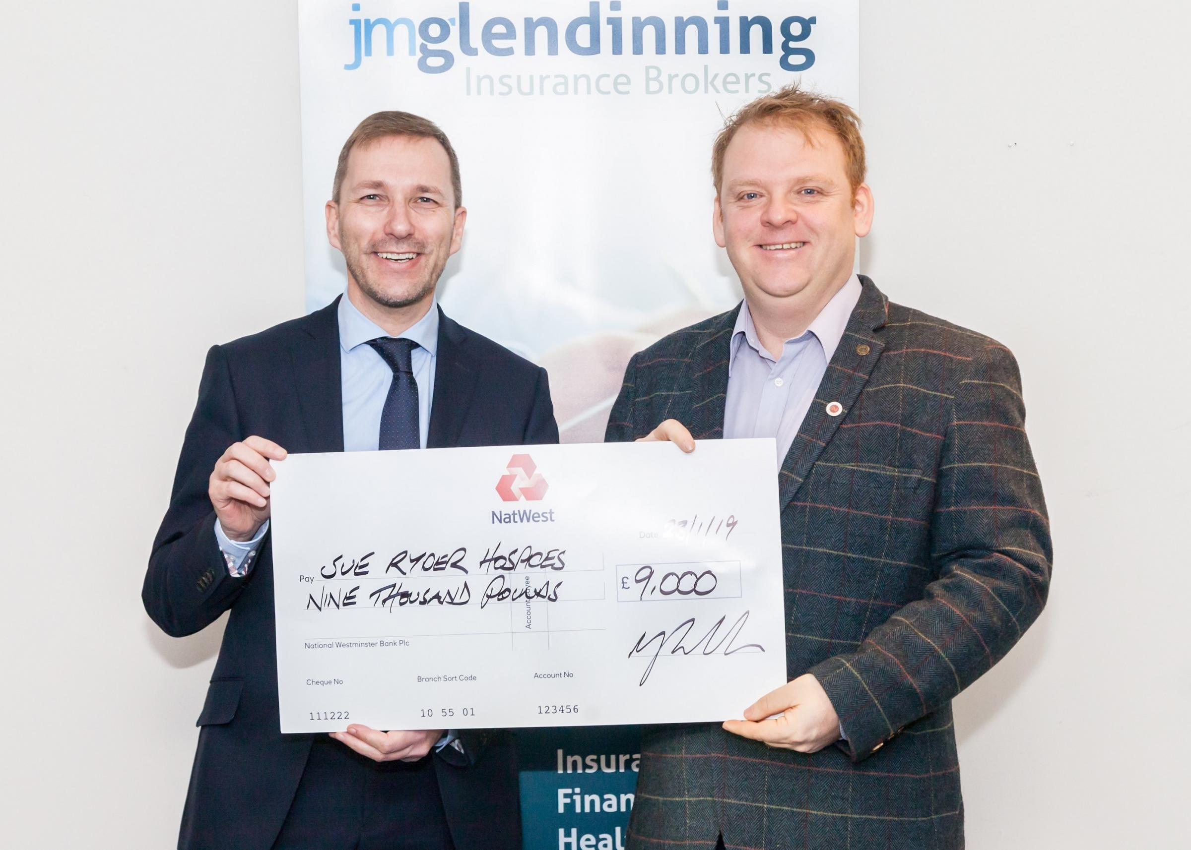 Nigel Wood, left, of JM Glendinning, presents a cheque to Andrew Wood, Manorlands community fundraising manager