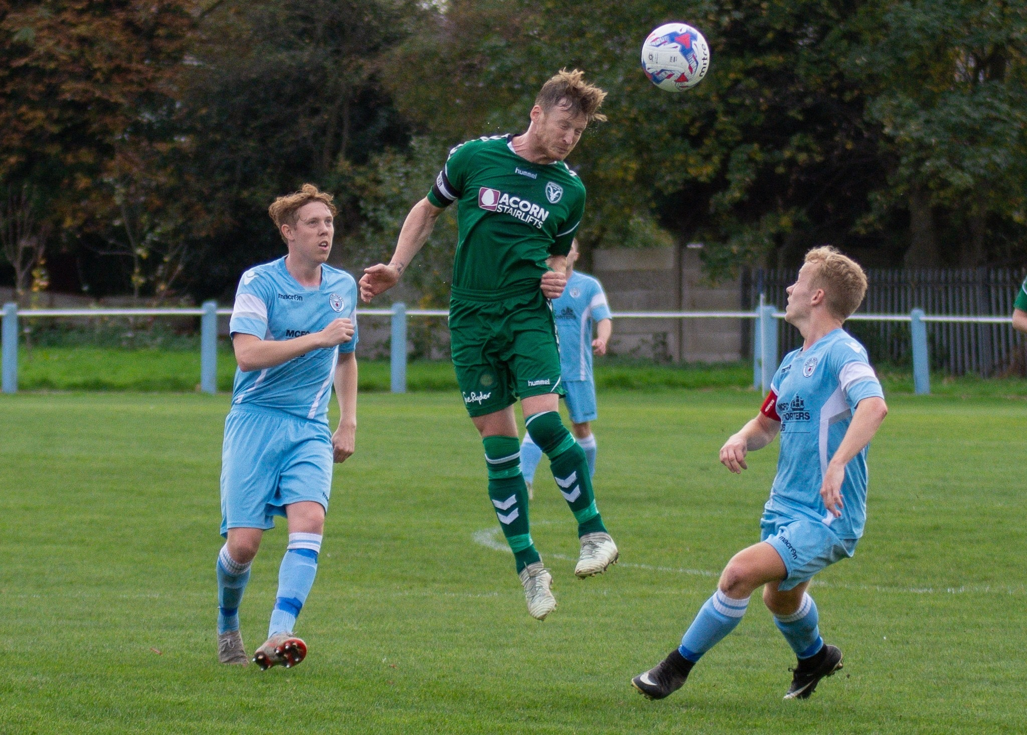 Steeton skipper Tim Hird in aerial action against Maine Road. Picture: John Chapman