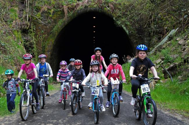 Young cyclists at the northern entrance to the Queensbury Tunnel.