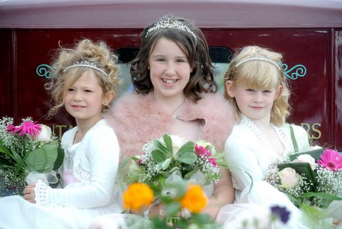 Gala queen Lucy Topham, 10, and attendants Francesca Hamer, 6, Lucy and Ellie Wakefield, 7