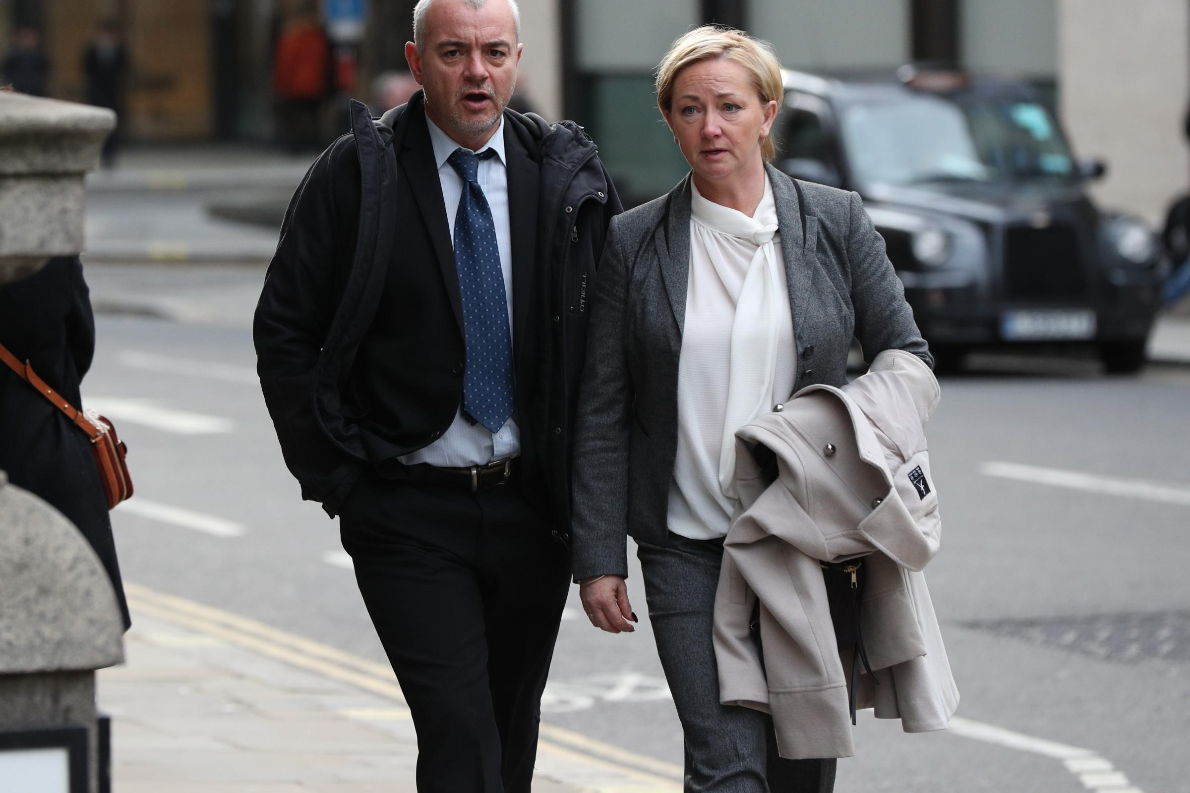 Detective constables Lee Pollard (left) and Sharon Patterson leaving the Old Bailey