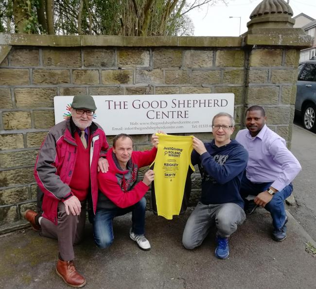 Marathon runner Roland Wright, second from right, with Good Shepherd Centre volunteers and secretary Graham Mitchell