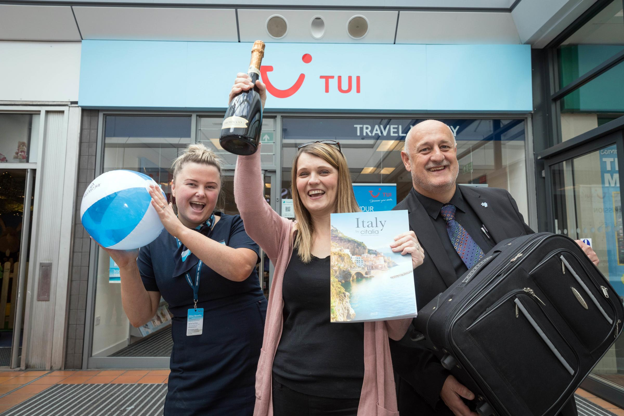 Winner Debbie Wharton, centre, celebrates with Airedale Shopping Centre manager Steve Seymour and Danielle Jordinson, travel advisor with TUI