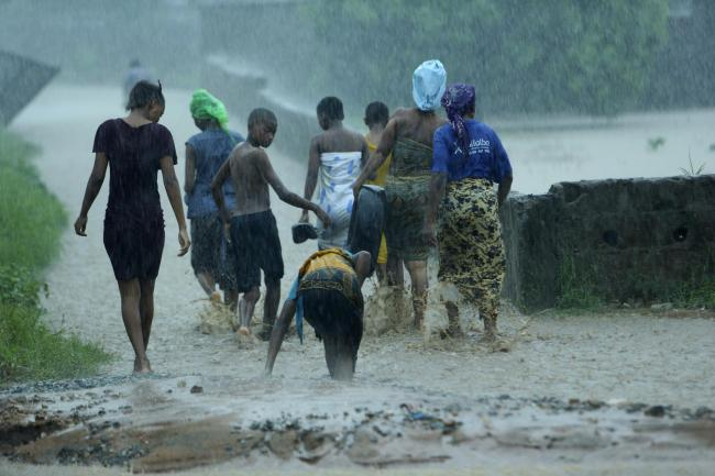 People leave their flooded homes in Pemba, on the north-eastern coast of Mozambique