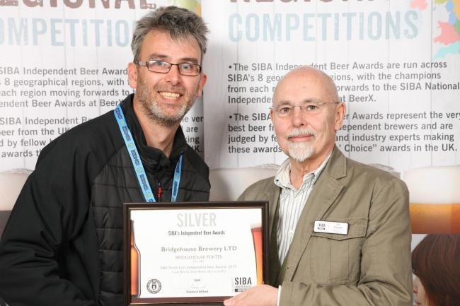 Bridgehouse Brewery salesman Andy Lumb, left, receives one of the awards from SIBA chairman Ian Fozard